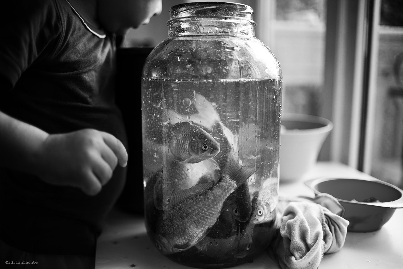 black and white, portraits, children, fish